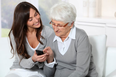 showing how to use mobile phone to grandmother